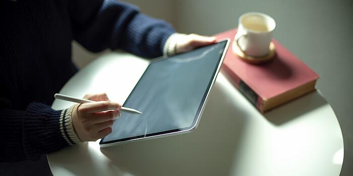 Person using tablet to research