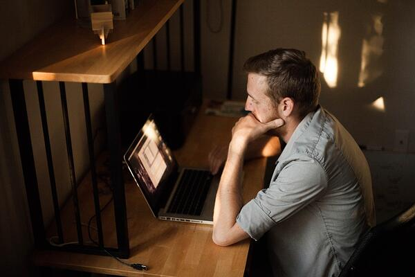 Man focused in evaluating his content on computer