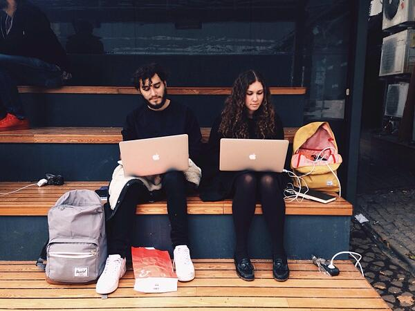 Two co-workers checking laptop for their content audits